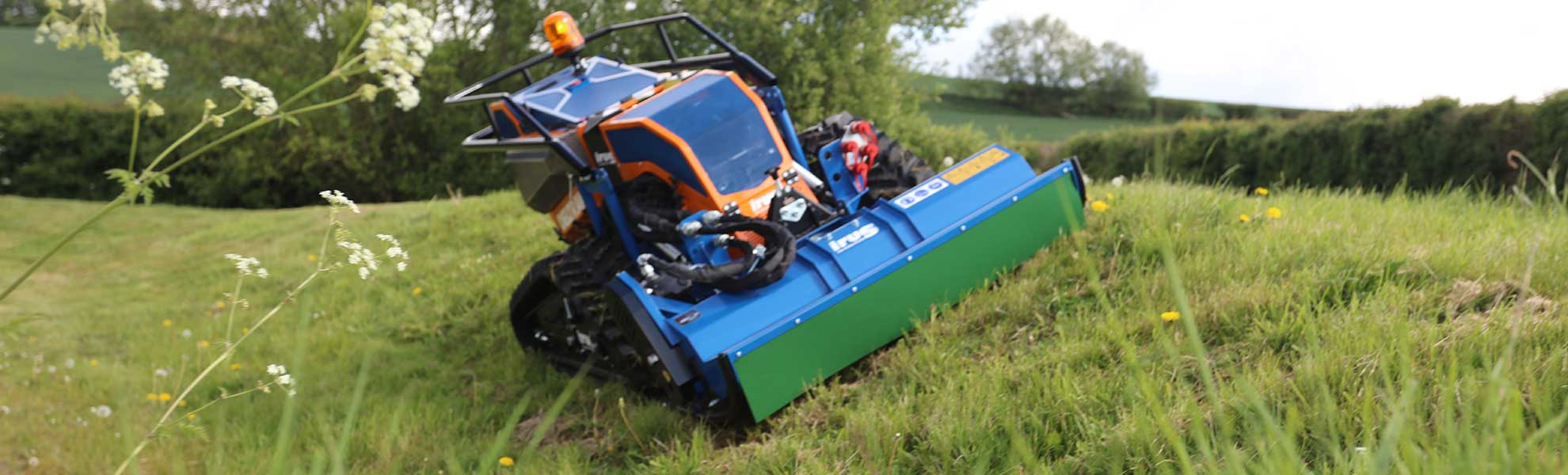 irus mower cutting grass on bank - Loxston Groundcare